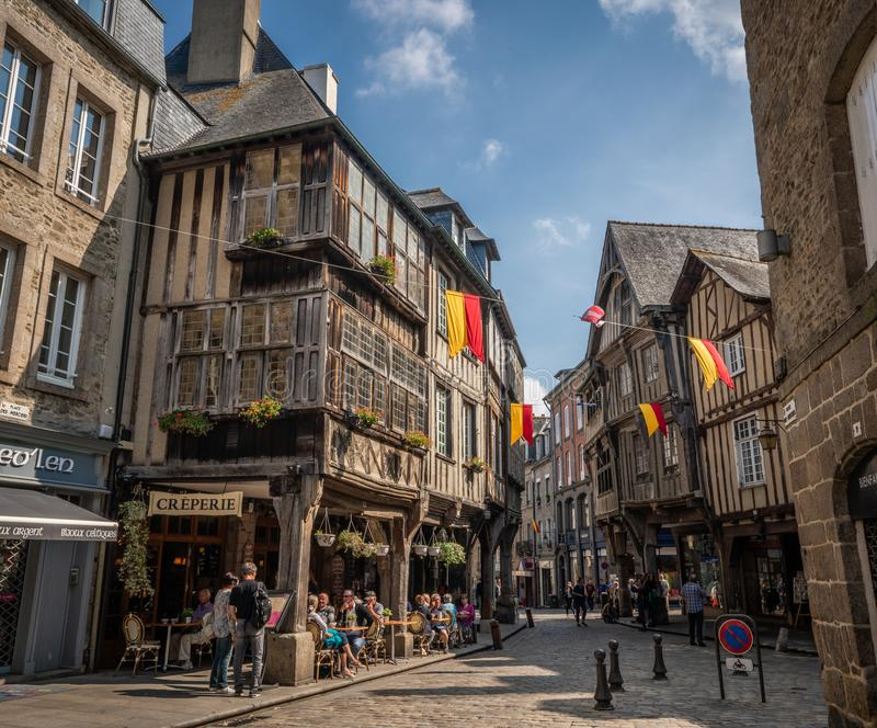 Sunny day in the old town center of medieval Dinan France. royalty free stock photo