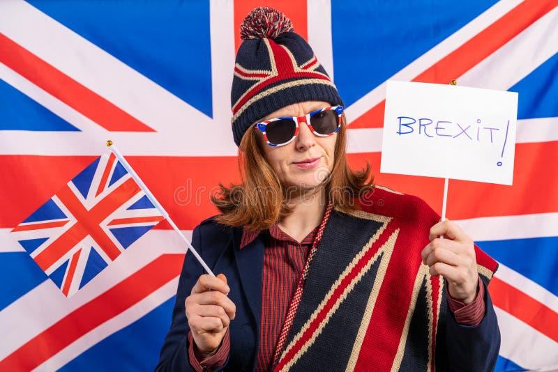 Brittisk kvinnaUK-flagga och Brexit baner royaltyfri fotografi