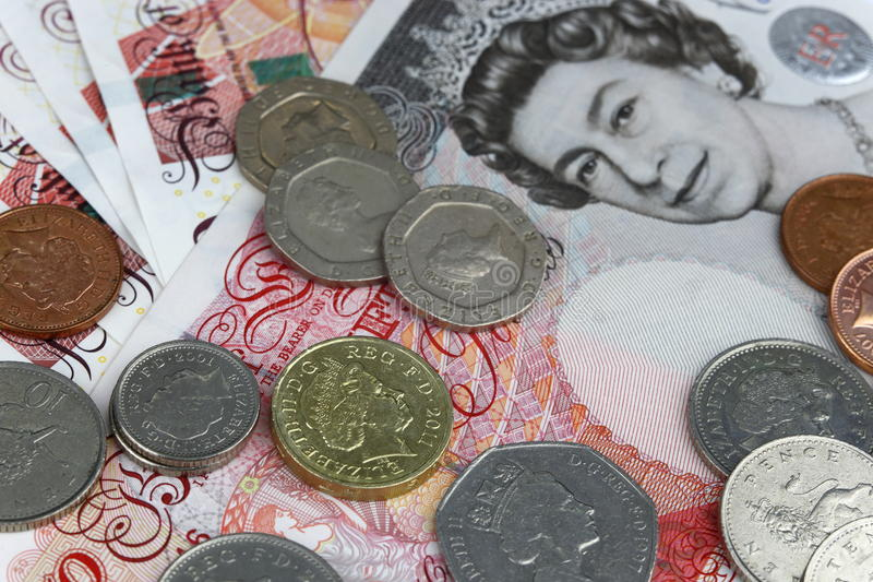 Brittiska pund för pengar arkivfoton