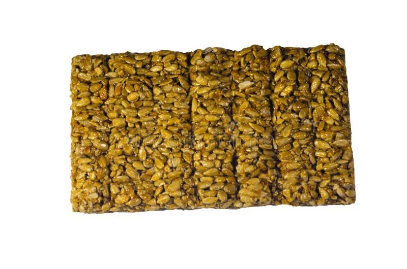 Brittles avec des graines de tournesol d'isolement sur le blanc photographie stock libre de droits