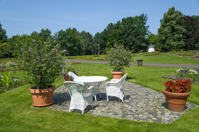 Britzer garten. Table and chairs standing on a lawn at the garden royalty free stock images