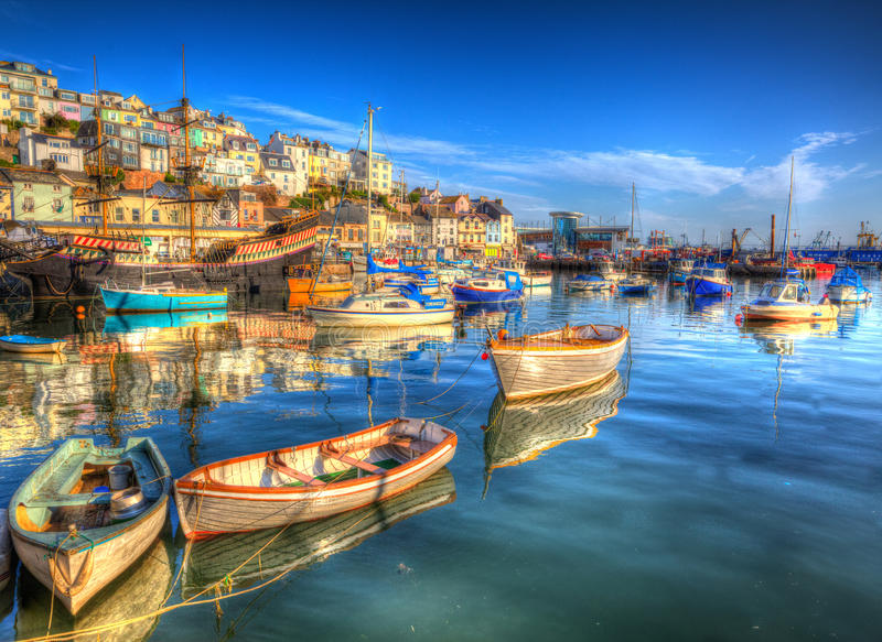 Brixham boats Devon England UK English harbour with brilliant blue sky stock photo