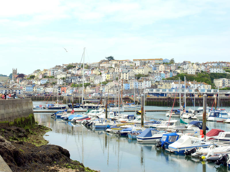 Brixham, Devon. The colorful tiered cottages and the marina in the foreground at Brixham, Torbay, Devon, England, UK stock image