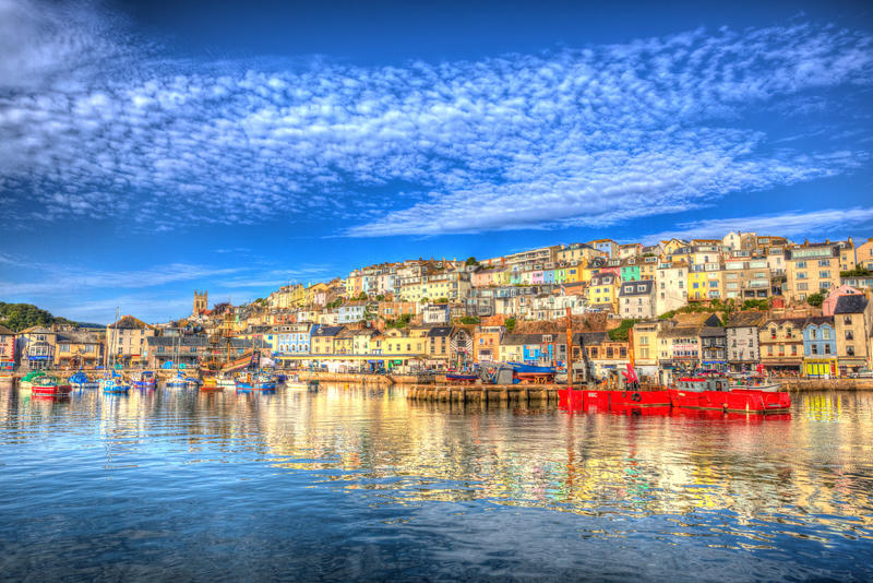 Brixham Devon England UK English harbour summer day with brilliant blue sky. Beautiful cloudscape and calm sea in colourful HDR royalty free stock photo