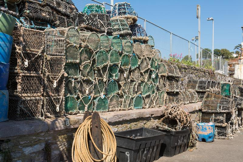 Brixham Harbour Devon. Lobster Pots in the Beautiful fishing port of Brixham near Torquay. A hive of activity. It is popular with holidaymakers for its royalty free stock photo