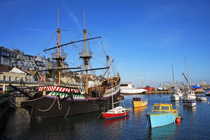 Brixham harbour. Golden Hind replica in Brixham harbour royalty free stock images