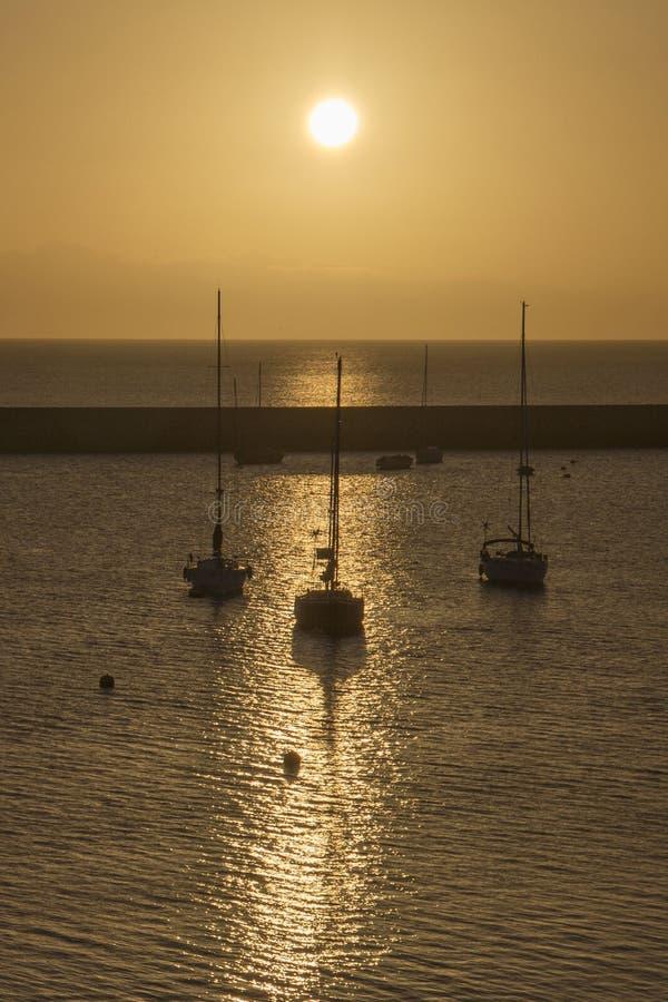 Harbour boats sunrise silhouette stock photos