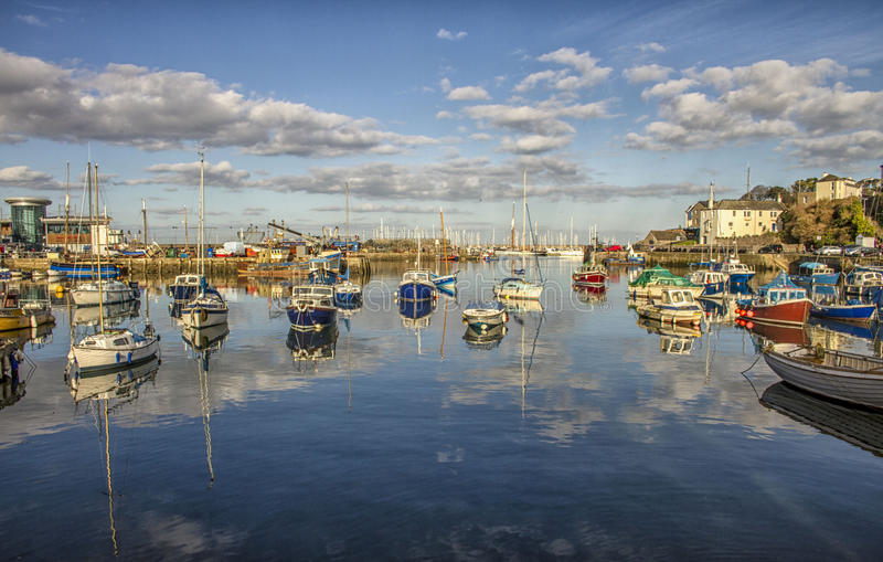 Brixham in the sun. Brixham Harbour on a still, sunny winter day stock photo