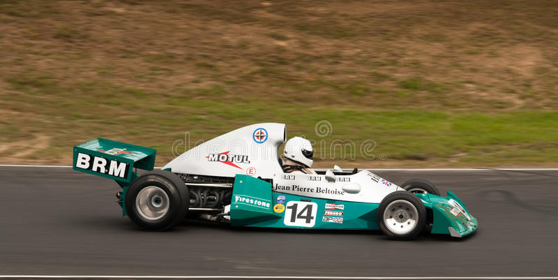 BRM Formula One racing car at speed. Festival of Motorsport: Festival of Motorsport: Jean Pierre Beltoise's 1974 BRM Formula One F1 race car competing in a stock photography