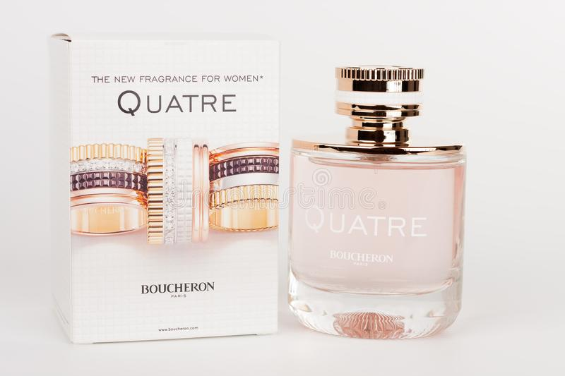 Bottle and box of the new fragrance for women Quatre Boucheron royalty free stock image
