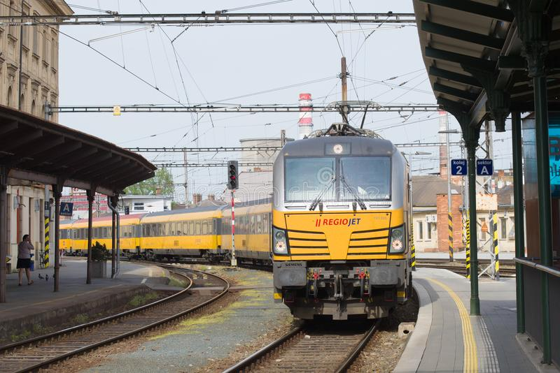 The passenger train of the transport company RegioJet arrives on the station. Brno, Czech Republic royalty free stock images