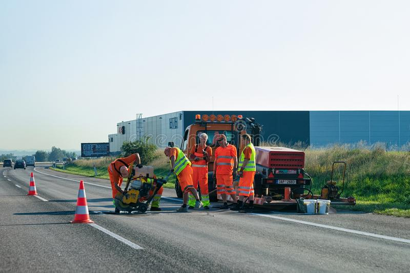 Workers doing road works. Brno, Czech Republic - September 19, 2018: Workers doing road works in Czech Republic royalty free stock photo