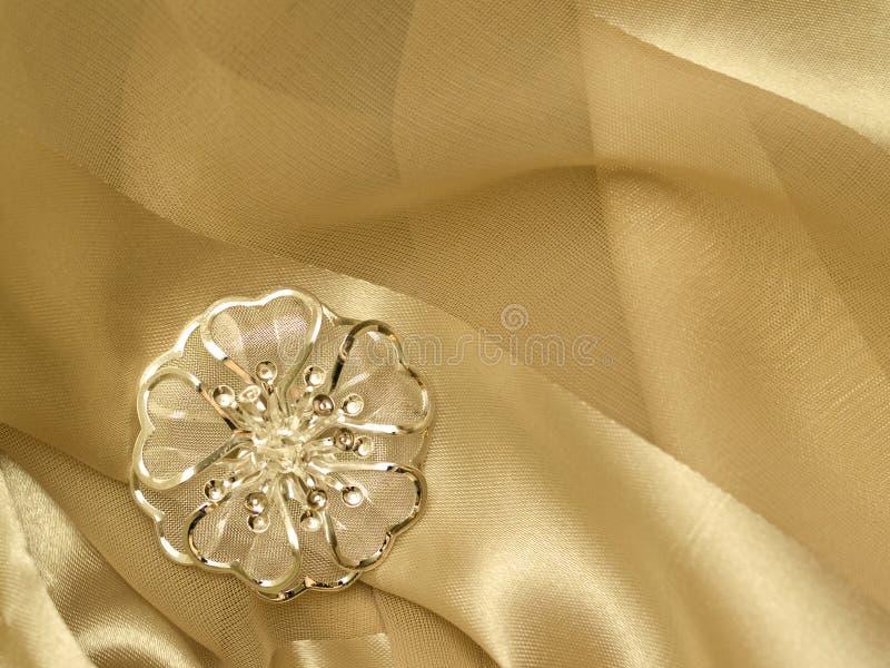 Broach beige silk royalty free stock image