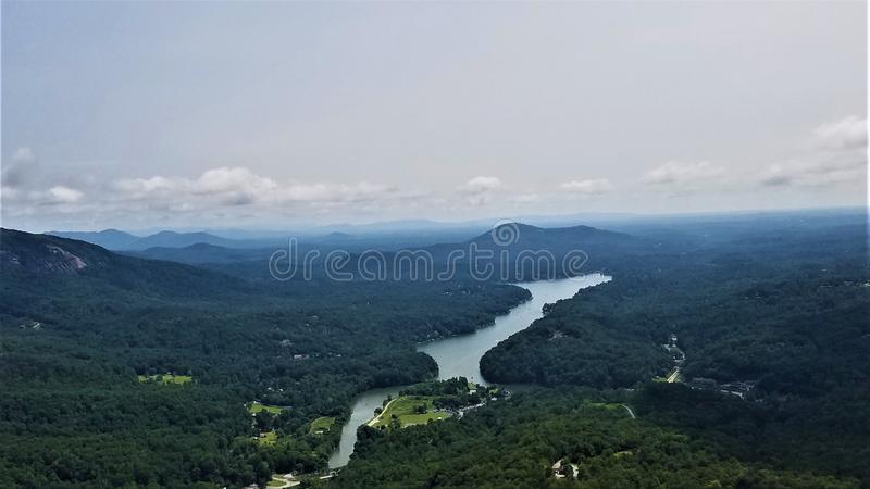 Lake Lure panorama. The Broad River flowing into Lake Lure, NC. This sweeping vista is visible from Chimney Rock. Photographed in August, the Appalachians are stock photo