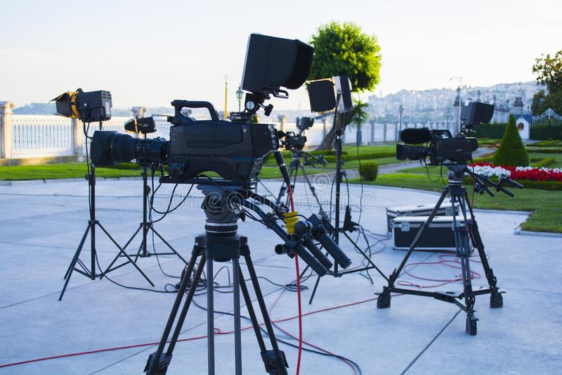 Broadcast tv; movie shooting or video production and film, tv crew team with camera stock photos