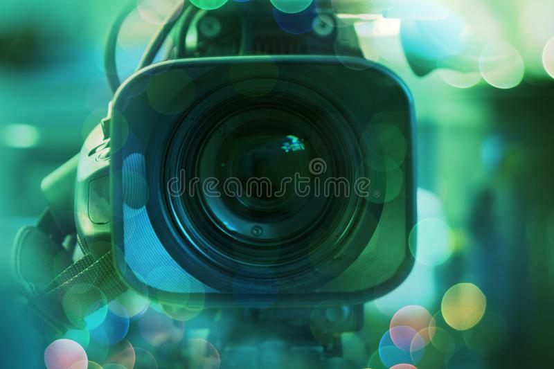 Broadcast video camera camcorder back in the studio TV show. Broadcasting, producers. Camera lens. Retro colorful stale. Broadcast video camera camcorder back royalty free stock photos