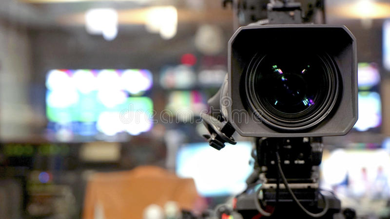 Broadcast video camera camcorder back in the studio TV show. Video camera viewfinder - recording in TV studio - Talking To The Camera royalty free stock images