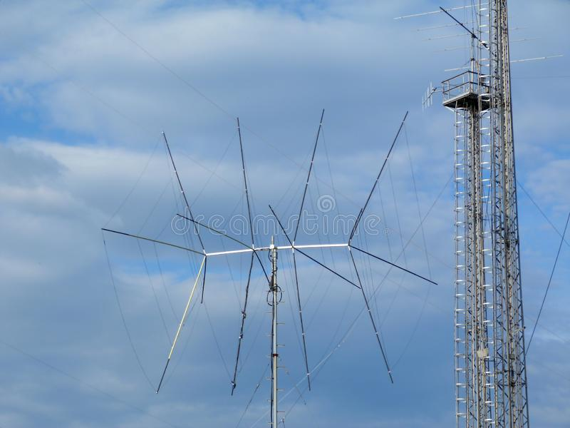 Broadcasting and cell transmitter and receiver antenna and communication tower. Symbolizing modern way of messaging and communications. tv signal receiving stock photography