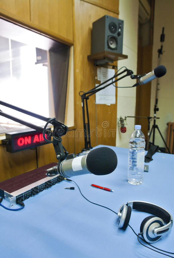 Broadcasting studio. Interior of broadcasting studio equiped with microphones, headset, speakers and other props for daily use in radio station stock images