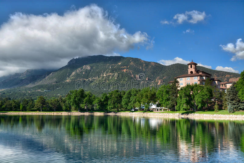 Broadmoor Hotel Resort with Lake and Cheyenne Mountain. The Broadmoor Hotel Resort, Lake and Cheyenne Mountain as a back drop royalty free stock photos