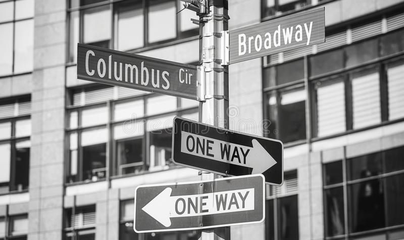 Broadway and Columbus Circle street name signs, New York. Black and white picture of Broadway and Columbus Circle street name signs, New York City, USA royalty free stock photography