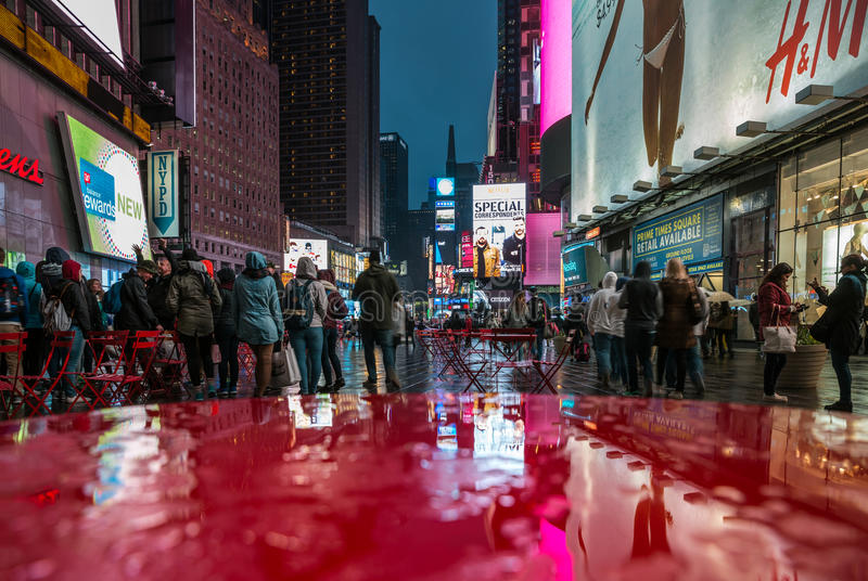 Broadway Street in New York. NEW YORK, USA - Apr 30, 2016: Broadway Street in New York in Times Square area on a rainy evening. Lights of advertising on streets stock images