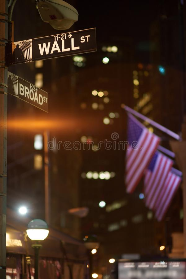 Broadway and Wall Street Signs at the night, Manhattan. Broadway and Wall Street Signs at the night with US flags on background, Manhattan, New York stock images
