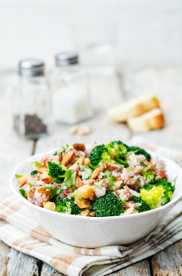 Broccoli chickpea cilantro almond white and red rice. Toning. selective Focus royalty free stock images