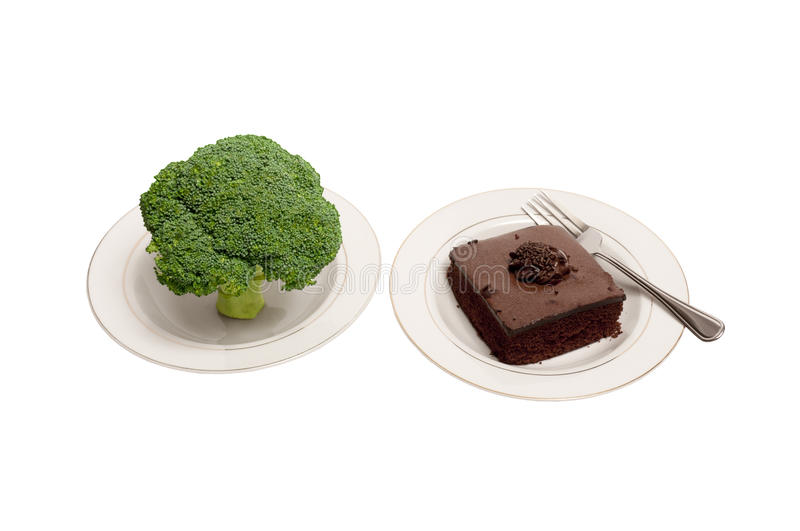 Broccoli and Chocolate Cake on White Plates