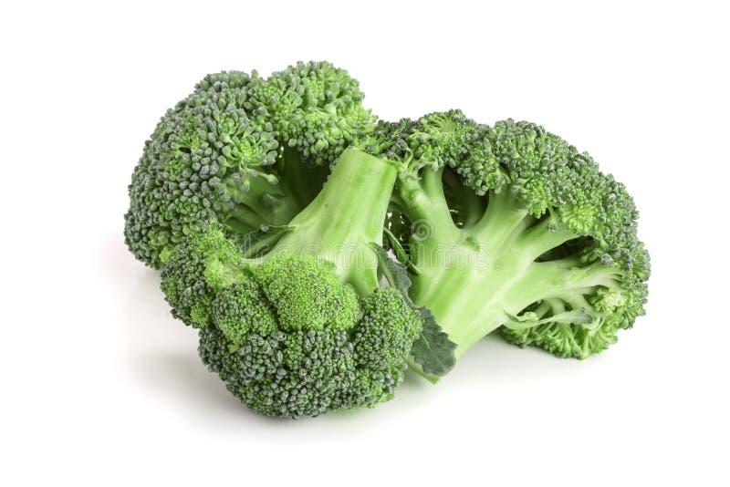 Broccoli freschi isolati sul primo piano bianco del fondo Vista superiore fotografie stock libere da diritti