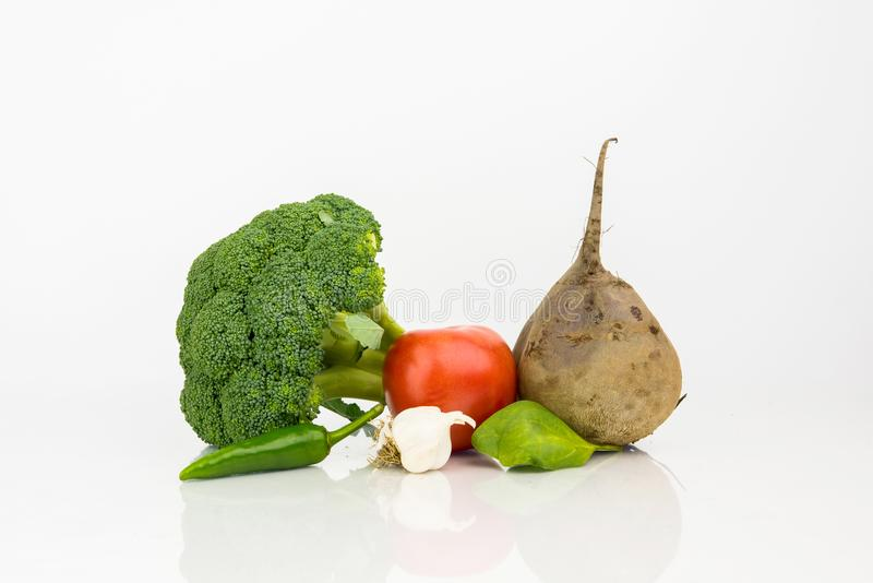 Broccoli, Green Hot Pepper, Garlic , Tomato And Beetroot. On White Background With Reflection royalty free stock photography