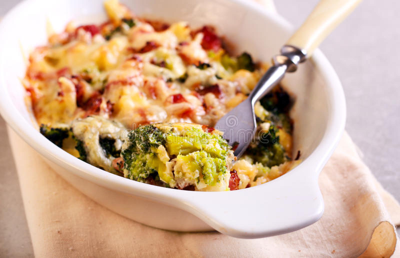 Broccoli and ham bake. In a tin stock photography