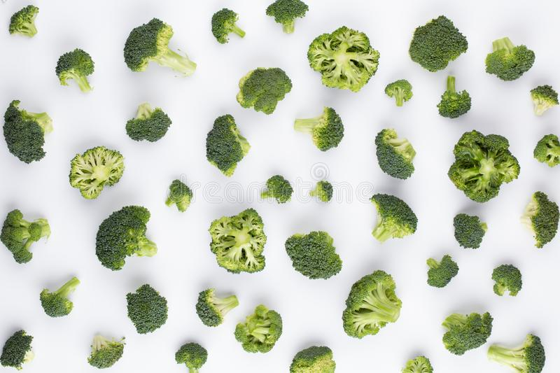 Broccoli pattern isolated on a white background. Various multiple parts of broccoli flower. Top view.  stock images