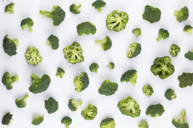 Broccoli pattern isolated on a white background. Various multiple parts of broccoli flower. Top view.  stock photos