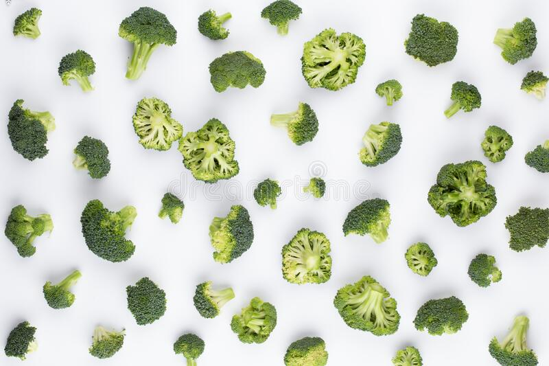 Broccoli pattern isolated on a white background. Various multiple parts of broccoli flower. Top view.  royalty free stock photography