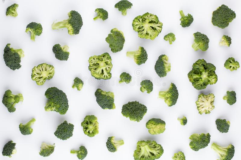 Broccoli pattern isolated on a white background. Various multiple parts of broccoli flower. Top view.  stock image
