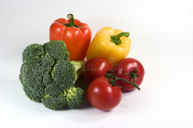Broccoli Peppers and Tomatoes stock images