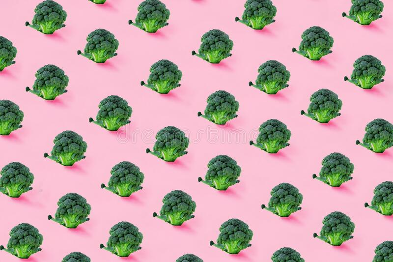 Broccoli on a pink background. Seamless minimalistic isometric pattern, photo collage, vegan pop art design, vegetable backdrop. Postcard, print on fabric stock images