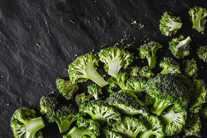 Broccoli at the right of the black stone background top view royalty free stock images
