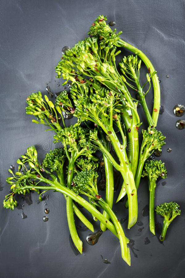 Broccolini with Chili Flakes and Olive Oil Top View stock photo