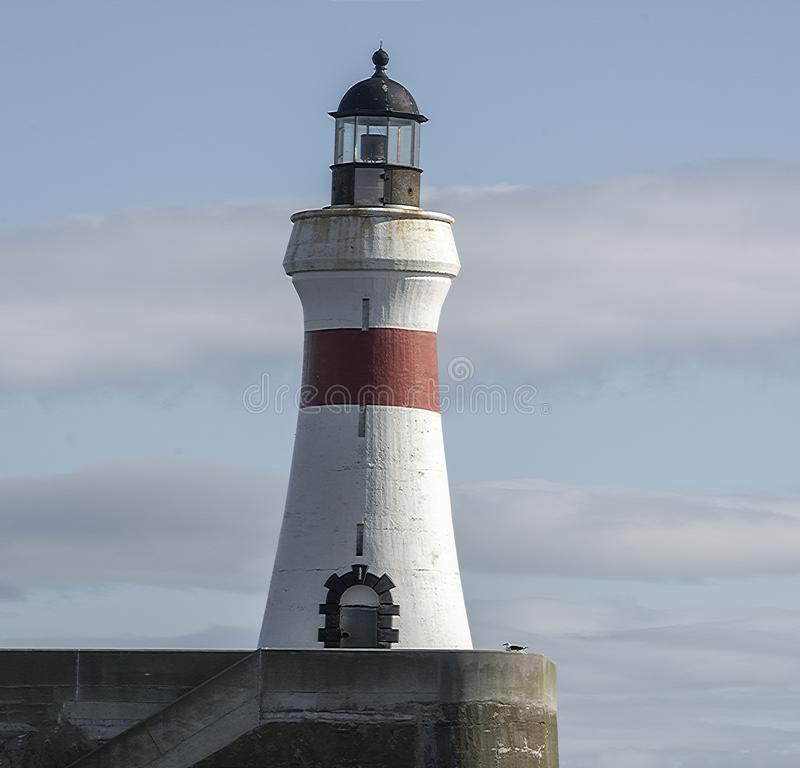 Lighthouse in daytime at Fraserburgh Harbour. Aberdeenshire, Scotland, UK. royalty free stock photos