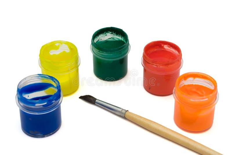 Brocha y pinturas multicoloras imagen de archivo