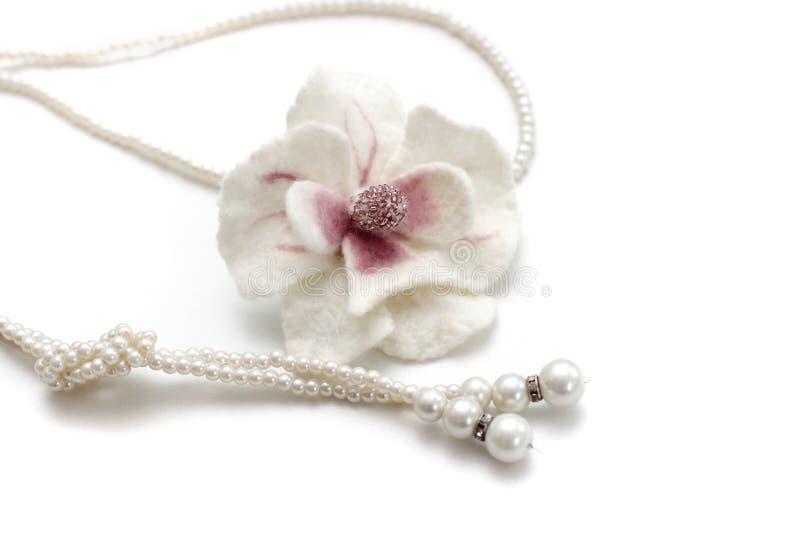 Broche da orquídea da flor da feltragem fotos de stock