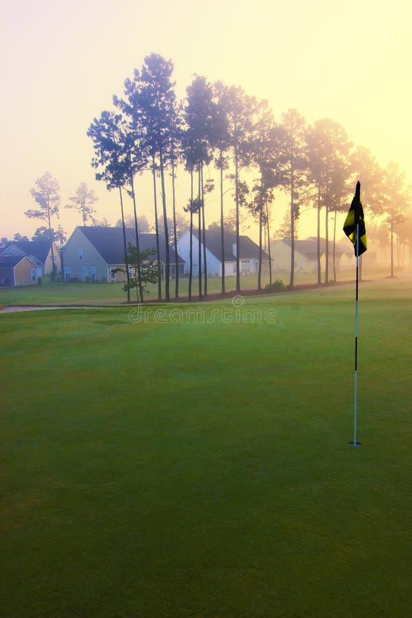 Broche et maisons de golf photographie stock libre de droits