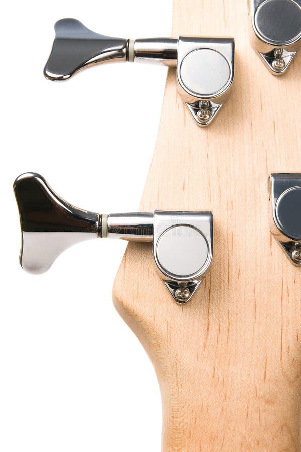 Broches en métal de tête de fingerboard de guitare basse images libres de droits