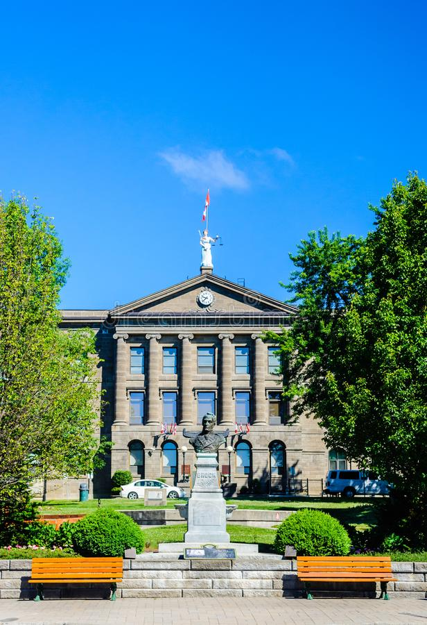 County court house and monument in Brockville, Ontario, Canada. BROCKVILLE, CANADA - JUNE 19, 2018: The county court house overlooks a monument of Sir Isaac royalty free stock images