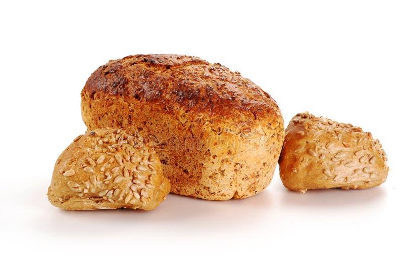 Broden van brood en broodjes die op wit wordt geïsoleerdn royalty-vrije stock afbeelding