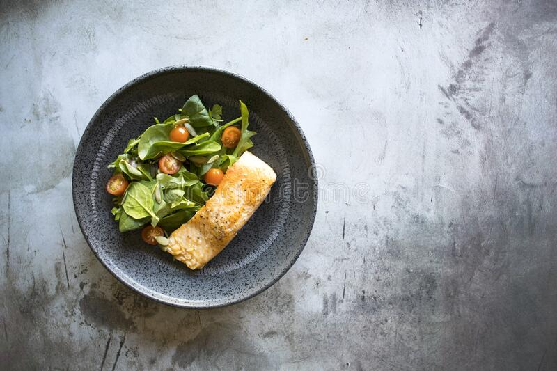 Broiled Salmon With Salad. With room for copy stock image