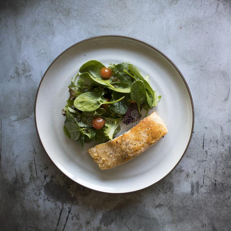 Broiled Salmon With Salad. With room for copy stock photo