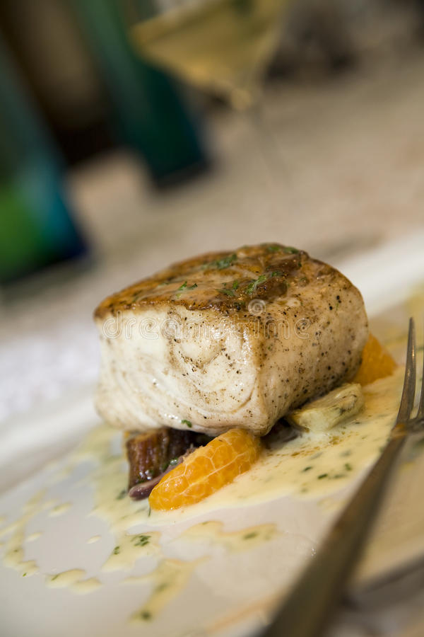 Broiled sea bass with citrus and beets. Served with white wine royalty free stock images